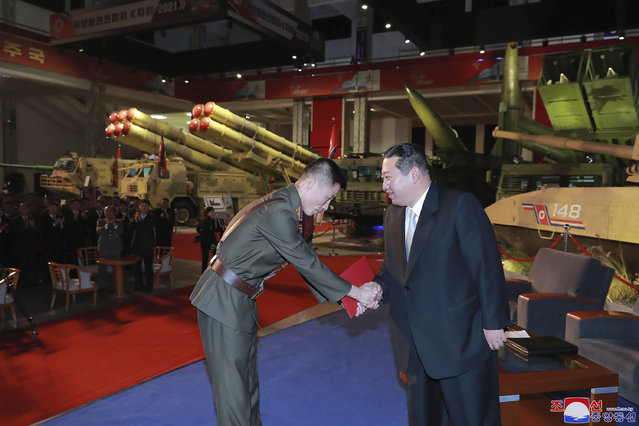 """In this photo provided by the North Korean government, North Korean leader Kim Jong Un, right, visits an exhibition of weapons systems in Pyongyang, North Korea, Monday, October 11, 2021. Kim reviewed the rare exhibition and vowed to build an """"invincible"""" military, as he accused the United States of creating regional tensions and lacking action to prove it has no hostile intent toward the North, state media reported Tuesday. Independent journalists were not given access to cover the event depicted in this image distributed by the North Korean government. The content of this image is as provided and cannot be independently verified. Korean language watermark on image as provided by source reads: """"KCNA"""" which is the abbreviation for Korean Central News Agency. (Photo by Korean Central News Agency/Korea News Service via AP Photo)"""