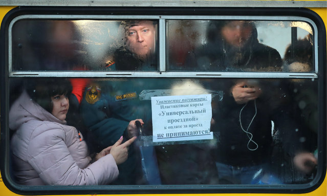 Passengers on a bus during a morning rush hour in Ivanovo, Russia on November 29, 2018. (Photo by Vladimir Smirnov/TASS)