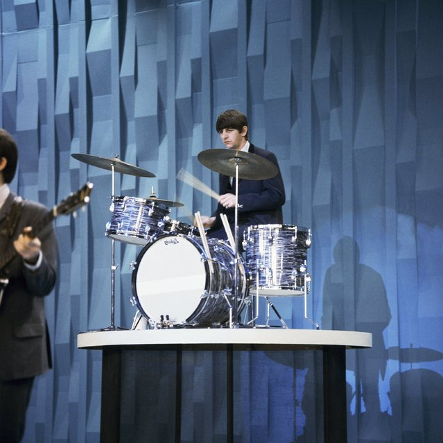 The Beatles Ringo Starr plays drums on the Ed Sullivan show in 1964. (Photo by AP Photo)