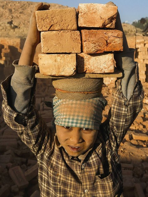 The work in brick kilns is seasonal and attracts the poorest of the poor. (Photo by Narendra Shrestha/EPA)