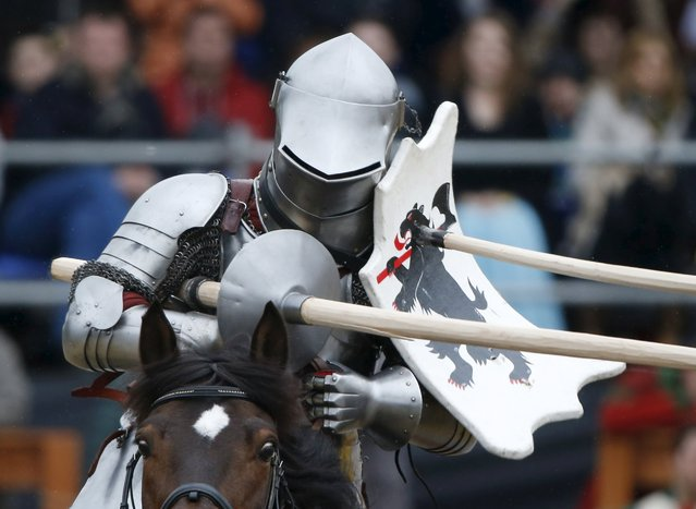 A participants rides a horse, holds a spear and wears a historic armoured suit of the Middle Ages during the Saint George international knight tournament in Moscow, Russia, May 3, 2015. (Photo by Maxim Zmeyev/Reuters)