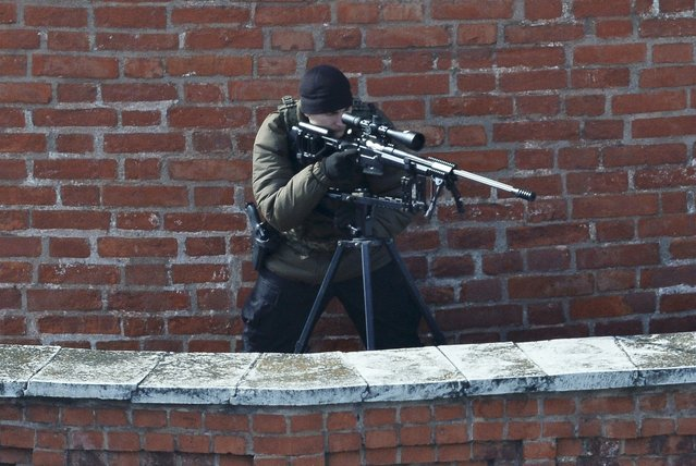 A sniper looks through a scope during the Victory Day parade at Red Square in Moscow, Russia, May 9, 2015. (Photo by Reuters/Host Photo Agency/RIA Novosti)