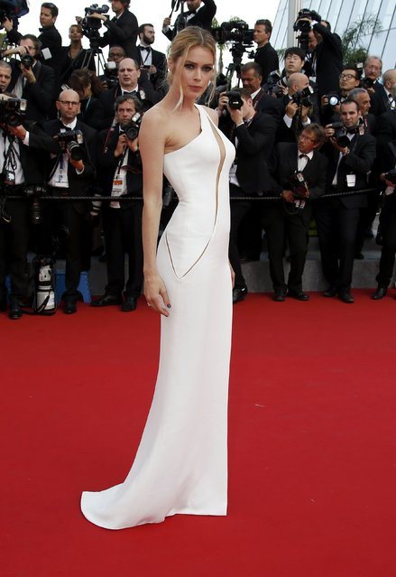 """Model Doutzen Kroes poses on the red carpet as she arrives for the opening ceremony and the screening of the film """"La tete haute"""" out of competition during the 68th Cannes Film Festival in Cannes, southern France, May 13, 2015. (Photo by Eric Gaillard/Reuters)"""