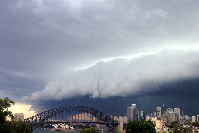 A large storm cloud covers the Sydney CBD on March 5, 2014 in Sydney, Australia. A severe thunderstorm warning was issued for the Sydney metropolitan area late this afternoon with heavy rainfall due to cause flash flooding in areas. (Photo by Matt Blyth/Getty Images)