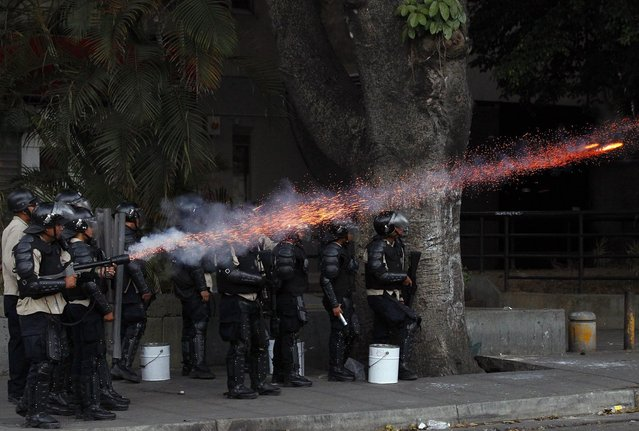 Police fire tear gas at anti-government protesters at Altamira square in Caracas March 6, 2014. (Photo by Carlos Garcia Rawlins/Reuters)