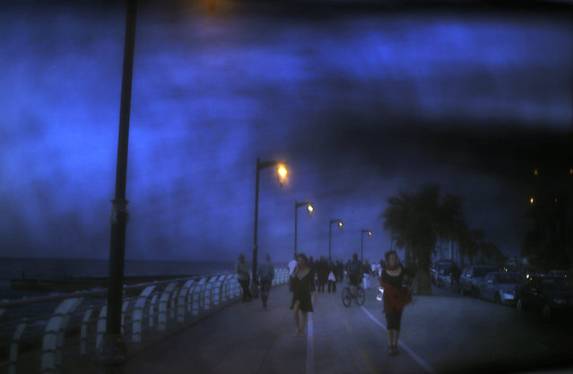 This Thursday, April 30, 2015 image shows women walking on the Corniche, or waterfront promenade in Beirut, Lebanon. (Photo by Hassan Ammar/AP Photo)
