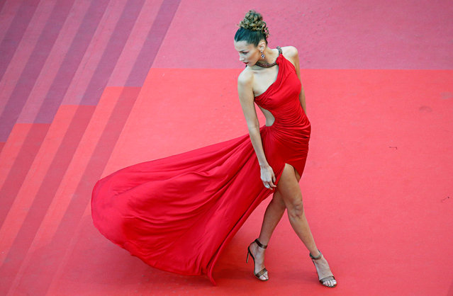 """US model Bella Hadid poses as she arrives for the screening of the film """"Dolor Y Gloria (Pain and Glory)"""" at the 72nd edition of the Cannes Film Festival in Cannes, southern France, on May 17, 2019. (Photo by Jean-Paul Pelissier/Reuters)"""