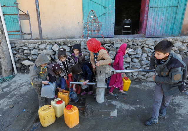 Afghan children collect water from a public water pump in Kabul, Afghanistan February 20, 2017. (Photo by Omar Sobhani/Reuters)