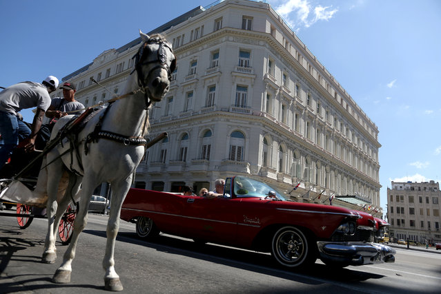 A horse carriage waits for tourists outside the Gran Hotel Manzana, owned by the Cuban government and managed by Swiss-based Kempinski Hotels SA, in Havana, Cuba April 17, 2019. (Photo by Fernando Medina/Reuters)