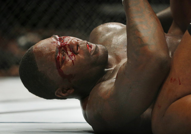 Anthony Johnson gets pounded by Daniel Cormier during their light heavyweight mixed martial arts title bout at UFC 187 on Saturday, May 23, 2015, in Las Vegas. (Photo by John Locher/AP Photo)