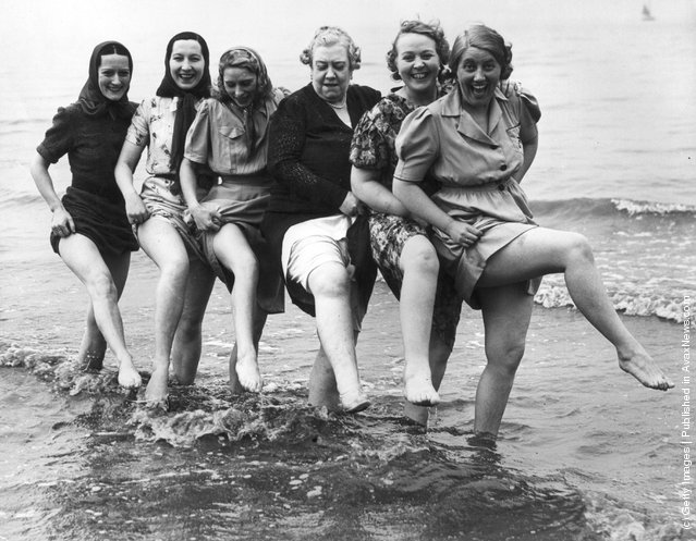 1939: Music hall singer Florrie Ford cavorting in the sea at Morecambe in Lancashire with her companions