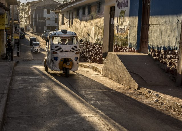"""""""Taxi Cholo"""". The tricycle or Taxi Cholo, the working tool of thousands of Peruvians. Photo location: Urubamba, Cusco, Peru. (Photo and caption by Johnny Mas-Bagá/National Geographic Photo Contest)"""