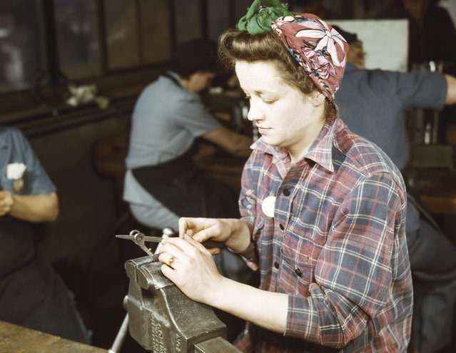 One of the girls of Vilter Manufacturing Co. filing small gun parts, Milwaukee, Wisconsin, 1943. (Photo by Howard R. Hollem/Buyenlarge/Getty Images)