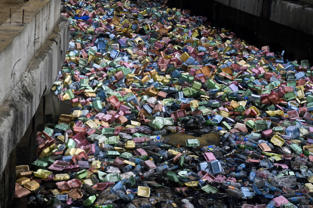 A dump of used foam takeout food containers floats and blocks a drainage points following a heavy storms in Lagos, on June 26, 2019. Lagos State Governor Babjide Sanwo-Olu, recently has declared a state of emergency on environmental sanitation and traffic management matters to check the resurgence of waste in the metropolis, environmental abuse, including illegal and indiscriminate dumping of refuse, especially on drainage points which mostly are responsible for flooding during raining reason. (Photo by Pius Utomi Ekpei/AFP Photo)