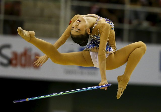 Gymnastics, Olympics Qualifier, Rio de Janeiro, Brazil on April 22, 2016: Jiahui Liu of China performs on the Rhythmic routine during the women's team competition. (Photo by Pilar Olivares/Reuters)