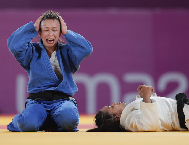Chile's Mary Dee Vargas (L) reacts after defeating Brazil's Larissa Farias compete in their Judo Women's –48 kg Bronze Medal contest during the Lima 2019 Pan-American Games in Lima on August 8, 2019. (Photo by Guadalupe Pardo/Reuters)