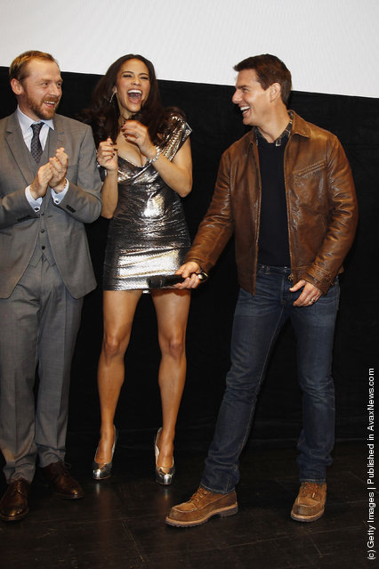 Actors Simon Pegg, Paula Patton and Tom Cruise attend the 'Mission:Impossible - Ghost Protocol' Germany Premiere at BMW Welt
