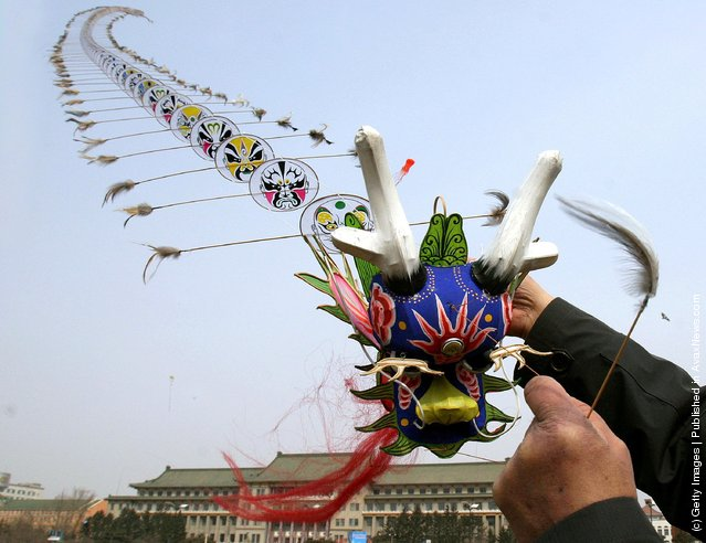 A man flies a dragon-shaped kite at a square on March 31, 2006 in Changchun of Jilin Province, China