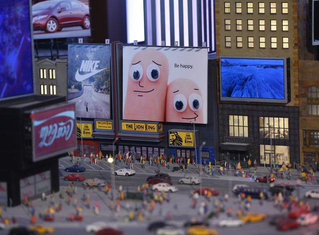A miniature model of Times Square in New York, part of Gulliver's Gate, a miniature world being recreated in a 49,000-square-foot exhibit space in Times Square, is seen during a preview April 10, 2017 in New York City. (Photo by Timothy A. Clary/AFP Photo)