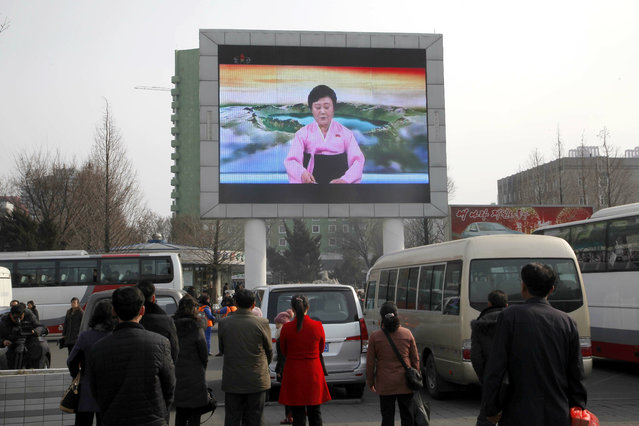 In this Wednesday, February 27, 2019, photo, North Koreans watch news about their leader Kim Jong Un's visit to Vietnam for his second summit with U.S. President Donald Trump, in Pyongyang, North Korea. North Koreans have been getting a quicker, more polished look at their leader as he meets with Trump in Hanoi in their second summit. (Photo by Jon Chol Jin/AP Photo)