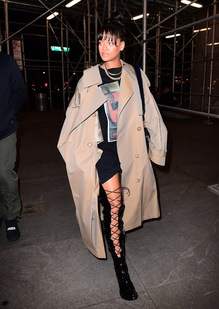 Rihanna showed up to a Business meeting looking mysterious in a Giant Oversized Trench coat on Wednesday in NYC on May 3, 2017. She hit her perfect figure underneath the large coat, but showed off her long legs in waist high patent leather lace up boots. She paired the look with a SCARFACE Al Pacino T Shirt, Gold Cuban link Chains, and a large Christian Dior Tote bag. (Photo by 247PAPS.TV/Splash News and Pictures)