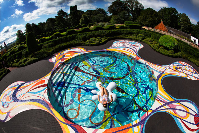 Gateway, a swimming pool designed by the Portuguese artist Joana Vasconcelos, is unveiled at the Jupiter Artland sculpture park in Edinburgh, Scotland on July 21, 2019, before it opens to the public as part of the Edinburgh art festival. (Photo by Murdo MacLeod/The Guardian)