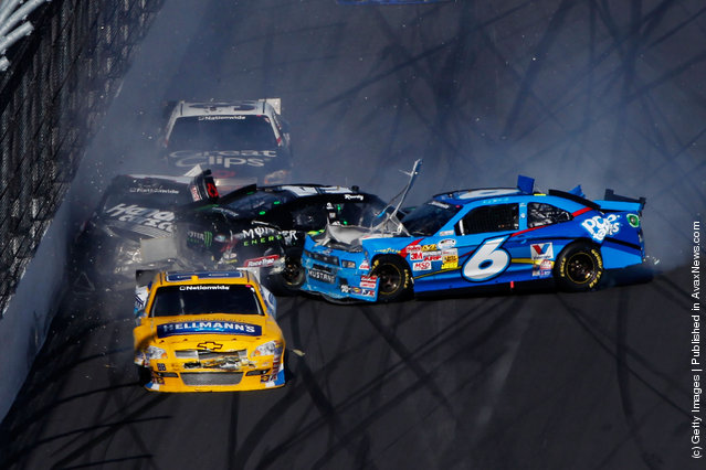 Ricky Stenhouse Jr., driver of the #6 Kellogg's Pop-Tarts Ford, spins into Kyle Busch, driver of the #54 Monster Energy Toyota, putting Kurt Busch, driver of the #1 HendrickCars.com Chevrolet, into the wall during the NASCAR Nationwide Series DRIVE4COPD 300 at Daytona International Speedway