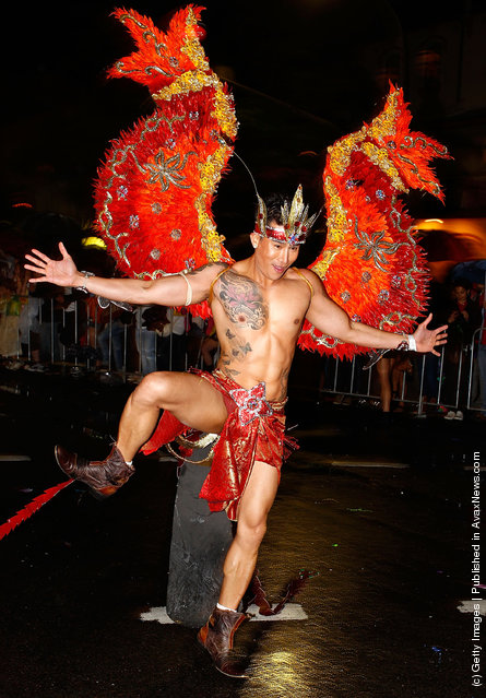 Participants march during the 2012 Sydney Gay & Lesbian Mardi Gras Parade