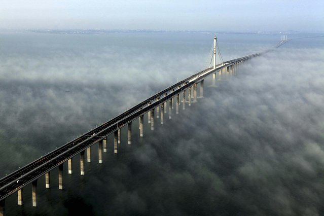This photo taken Wednesday, June 29, 2011 released by China's Xinhua news agency shows the Jiaozhou Bay Bridge in Qingdao, east China's Shandong Province. China opened Thursday, June 30, 2011, the world's longest cross-sea bridge, which is 42 kilometers (26 miles) long and links China's eastern port city of Qingdao to an offshore island, Huangdao. (Photo by Yan Runbo/AP Photo/Xinhua)