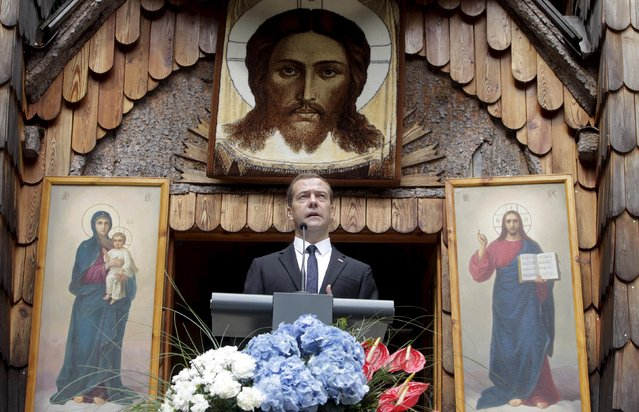 Russian Prime Minister Dmitry Medvedev speaks during the commemoration of the Russian Chapel in Vrsic, Slovenia July 26, 2015. The Russian Chapel was built in 1916 in memory of more than 200 Russian prisoners of war who were killed in an avalanche while building a military road pass over the Vrsic during World War One. (Photo by Srdjan Zivulovic/Reuters)