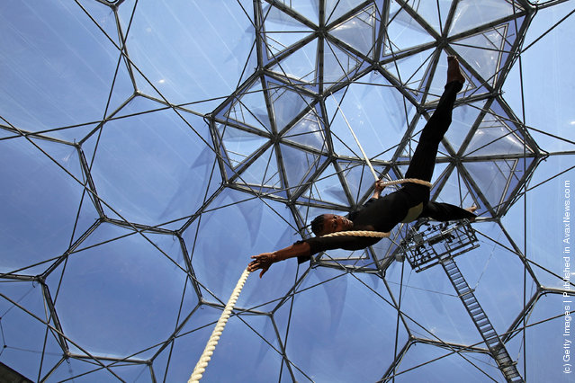 Circus performer Kevin McIntosh climbs a aerial rope as he performs at a preview for NoFit State Circus new summer show at the Eden Project