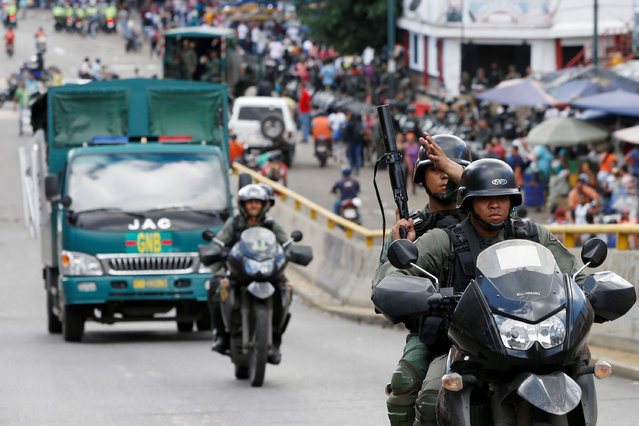 Venezuelan National Guards patrol after looting attempts, according to local media, in the slum of Petare in Caracas, Venezuela June 9, 2016. (Photo by Carlos Garcia Rawlins/Reuters)