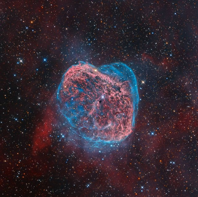 NGC 6888 by Mark Hanson (USA). This colourful starscape taken from Rancho Hidalgo, New Mexico, USA reveals the searing heat of the Crescent Nebula glowing in a whirl of red and blue. The emission nebula is a colossal shell of material ejected from a powerful but short-lived Wolf-Rayet star (WR 136), seen close to the image centre. Ultraviolet radiation and stellar wind now heats the swelling cloud, causing it to glow. (Photo by Mark Hanson)