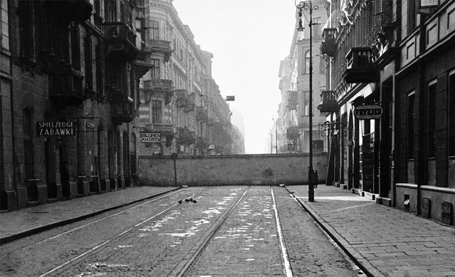 A newly-constructed wall partitions the central part of Warsaw, Poland, seen on December 20, 1940. It is part of red brick and gray stone walls built 12 to 15 feet high by the Nazis as a ghetto – a pen for Warsaw's approximately 500,000 Jews