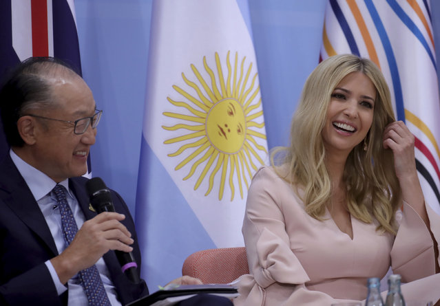 """President of World Bank Group, Jim Yong Kim, left, and the daughter and advisor of U.S. president Donald Trump, Ivanka   take part in a panel discussion  """"Launch Event Women's Entrepreneur Finance Initiative"""" during the G-20 summit in Hamburg, Germany,  Saturday, July 8, 2017. (Photo by Michael Kappeler/Pool Photo via AP Photo)"""