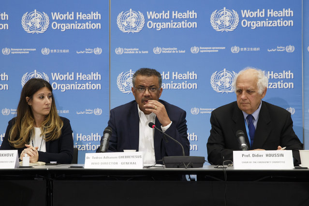 From left, Maria van Kerkhove, Head of Emerging Diseases and Zoonoses Unit, Director General of the World Health Organization, WHO, Tedros Adhanom Ghebreyesus, and Professor Didier Houssin, the Chair of the Emergency Committee hold a press conference  after an Emergency Committee meeting on what scientists have identified as a new coronavirus, at the World Health Organization (WHO) headquarters in Geneva, Switzerland, Wednesday, January 22, 2020. Health authorities are closely watching an outbreak of respiratory illness caused by a new virus from China. Governments are stepping up surveillance of airline passengers from central China and taking other steps to try to control the outbreak. (Photo by Salvatore Di Nolfi/Keystone via AP Photo)