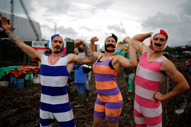 Revellers pose for a picture at Worthy Farm in Somerset during the Glastonbury Festival, Britain, June 26, 2016. (Photo by Stoyan Nenov/Reuters)