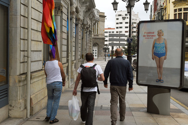 People walk with rainbow flags at the end of a LGBT Pride parade in Oviedo, northern Spain, June 28, 2016. (Photo by Eloy Alonso/Reuters)