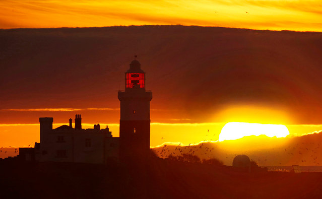 The sun rises over Coquet Island off the coast of Northumberland, England on April 7, 2017. Temperatures are forecast to rise across the UK over the weekend with Sunday expected to be the hottest day so far this year. (Photo by Owen Humphreys/PA Wire)