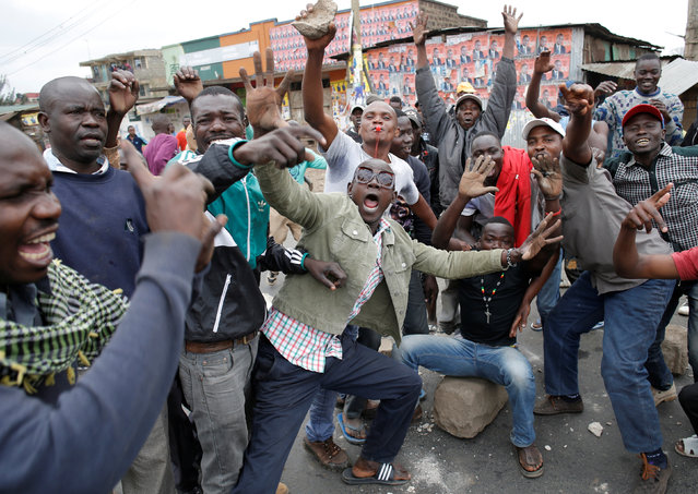 Supporters of opposition leader Raila Odinga gesture in Mathare slum in Nairobi, Kenya, August 9, 2017. (Photo by Goran Tomasevic/Reuters)