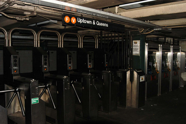 Subway station at 23rd street and 6th avenue is empty after New York was hit by the largest power blackout in American history, August 14, 2003. It stranded thousands of commuters, trapped subway riders underground and created a transportation nightmare. (Photo by Jason Nevader/WireImage)
