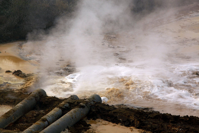 Pipes coming from a rare earth smelting plant spew polluted water into a vast tailings dam near Xinguang Village, located on the outskirts of the city of Baotou in China's Inner Mongolia Autonomous Region in this October 31, 2010 picture. (Photo by David Gray/Reuters)