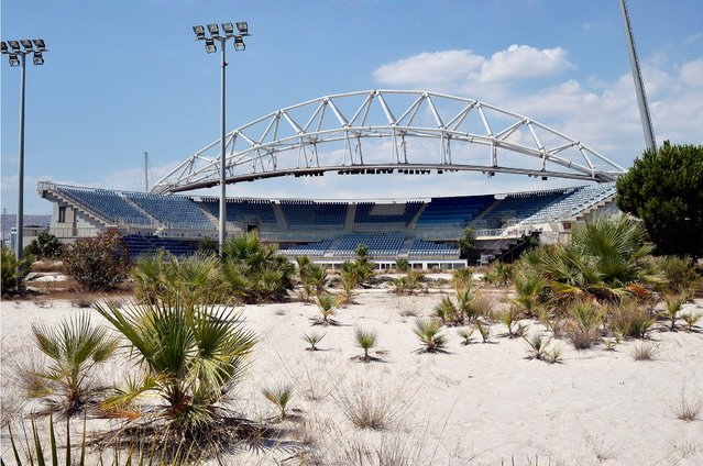 """General view of the Beach Volleyball Olympic Stadium at Faliro Olympic Complex in Athens, Greece on July 31, 2014. Ten years ago the XXVIII Olympiad was held in Athens from the 13th – 29th August with the motto """"Welcome Home"""". (Photo by Milos Bicanski/Getty Images)"""