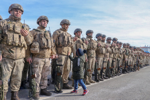 Commandos seen off by their relatives ahead of their departure to join Turkey's 'Operation Spring Shield', on March 05, 2020 in Turkey's Van province. A ceremony held for 210 Commandos who will join in Turkey's Operation Spring Shield in Idlib. They seen off with prays of their families and relatives. (Photo by Mesut Varol/Anadolu Agency via Getty Images)