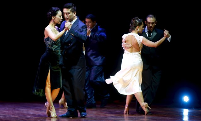 Victor Ho Jon Cho (2nd L) and Adelina Yoon Woo Kim from South Korea, who are representing the city of Seoul, dance next to Ariel Manzanares (R) and Antonella Sarago from Argentina during the Salon style final round at the Tango World Championship in Buenos Aires August 26, 2015. (Photo by Marcos Brindicci/Reuters)