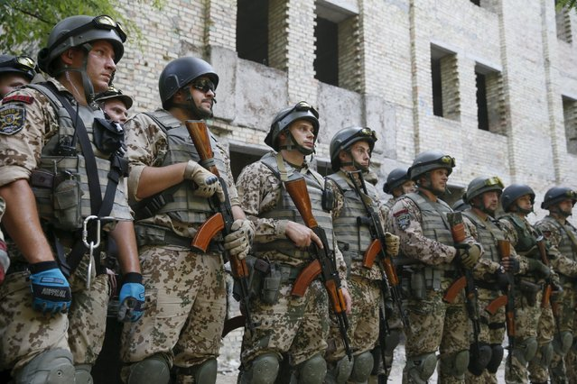 Members of the Ukrainian Interior Ministry's special battalion Kiev-1 stand in line as they take part in an anti-terror drill in Kiev, Ukraine, August 28, 2015. (Photo by Valentyn Ogirenko/Reuters)