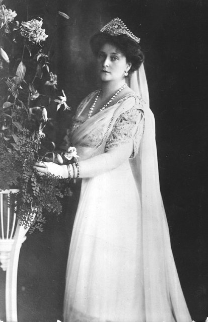 Alexandra (Alix) Feodorovna (1872–1918), German Princess and Empress of Russia as the wife of Tsar Nicholas II, whom she married in 1894. When the revolution broke out, she was imprisoned with the rest of the royal family in 1917, and later shot at Ekaterinberg. Circa 1912.