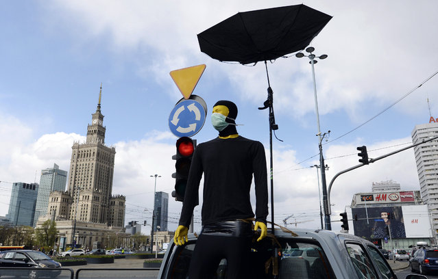A symbol of male support is seen as women, self isolated in their cars to protect against coronavirus, take part in a protest against plans for the parliament to debate a draft law tightening Poland's ban on most abortions this week, in Warsaw, Poland, Tuesday, April 14, 2020. (Photo by Czarek Sokolowski/AP Photo)
