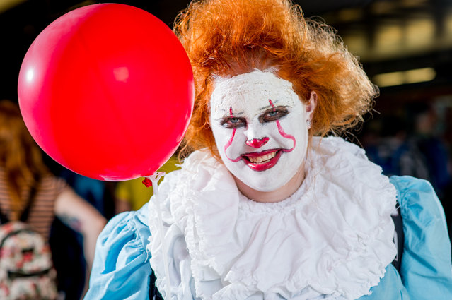 A fan cosplays as Pennywise the Dancing Clown from the movie IT during 2017 New York Comic Con, Day 2 on October 6, 2017 in New York City. (Photo by Roy Rochlin/WireImage,)