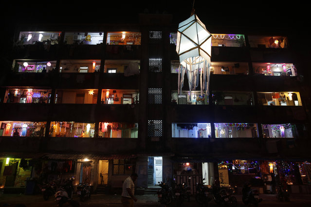 A tenement block housing mostly fishermen families is illuminated with lights during Diwali in Mumbai India, Thursday, October 19, 2017. Diwali, the Hindu festival of lights, is being celebrated across the country Thursday. (Photo by Rafiq Maqbool/AP Photo)